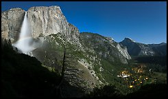 Upper Yosemite Fall with moonbow, Yosemite Village, and Half-Dome. Yosemite National Park, California, USA.