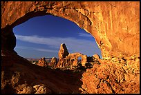 Turret Arch seen through South Window, sunrise. Arches National Park, Utah, USA. (color)