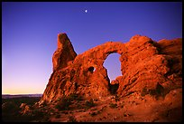 Turret Arch and moon, dawn. Arches National Park, Utah, USA. (color)