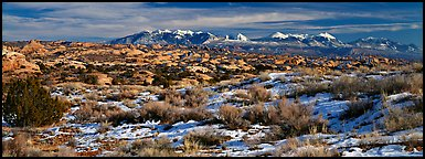 Petrified dunes and mountains in winter. Arches National Park (Panoramic color)
