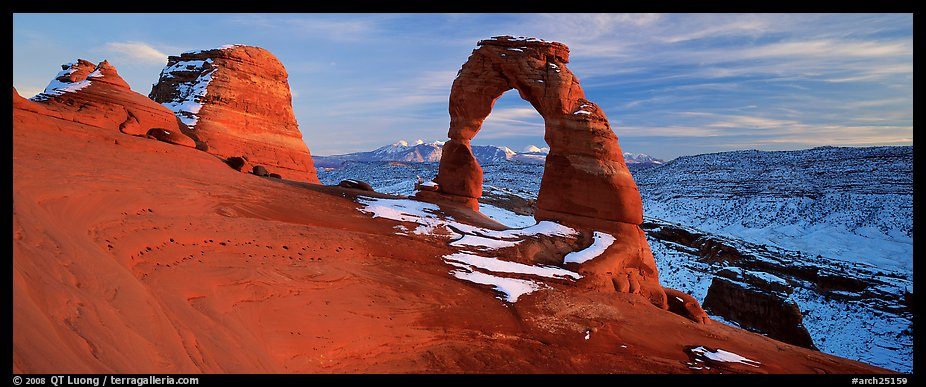 Desert Arch and mountains at sunset. Arches National Park (color)