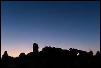 Windows Group silhouette at dawn. Arches National Park, Utah, USA. (color)