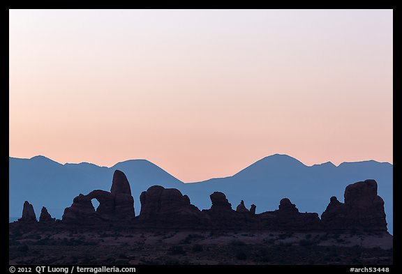 Turret Arch, spires, and mountains at dawn. Arches National Park (color)