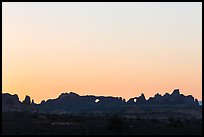 Windows Group backlit at sunrise. Arches National Park, Utah, USA. (color)