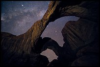 Double Arch at night with Milky Way. Arches National Park, Utah, USA. (color)