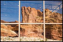 Sandstone walls, Visitor Center window reflexion. Arches National Park, Utah, USA. (color)