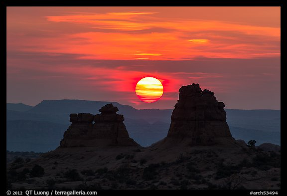 Sun setting between rock towers. Arches National Park (color)