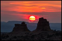 Sun setting between rock towers. Arches National Park ( color)