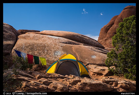 Tent with prayer flags amongst sandstone rocks. Arches National Park (color)