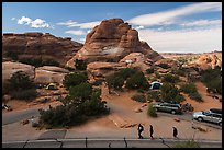 People walking in Devils Garden  Campground. Arches National Park, Utah, USA. (color)