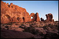 Cove of Arches, Double Arch, and Parade of Elephants at dusk. Arches National Park, Utah, USA. (color)