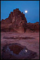 Courthouse tower and moon at night. Arches National Park, Utah, USA. (color)