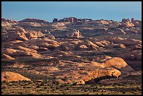 Sandstone domes with arch in background. Arches National Park, Utah, USA. (color)