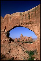 Turret Arch seen through South Window, morning. Arches National Park, Utah, USA.