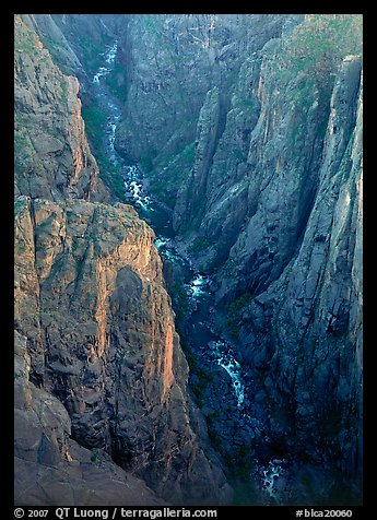 View down steep rock walls and narrow chasm. Black Canyon of the Gunnison National Park (color)