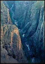 View down steep rock walls and narrow chasm. Black Canyon of the Gunnison National Park, Colorado, USA. (color)
