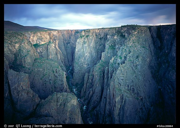 Narrow gorge under dark clouds. Black Canyon of the Gunnison National Park, Colorado, USA.