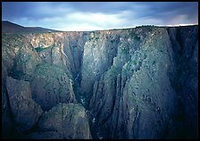 Narrow gorge under dark clouds. Black Canyon of the Gunnison National Park ( color)