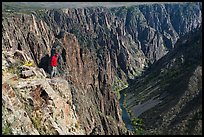 Park visitor looking, Pulpit rock overlook. Black Canyon of the Gunnison National Park, Colorado, USA. (color)