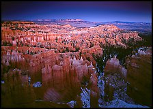 View of Bryce Amphitheater hoodoos from Sunset Point at dusk. Bryce Canyon National Park, Utah, USA.