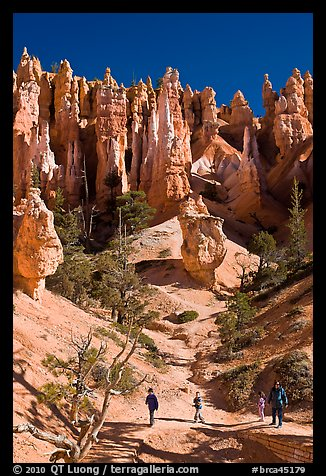 Hiker at the base of hoodoos. Bryce Canyon National Park (color)