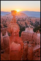 Sun rising behind Thor Hammer. Bryce Canyon National Park, Utah, USA. (color)