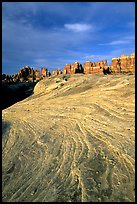 Sandstone striations and Needles near Elephant Hill, sunrise. Canyonlands National Park, Utah, USA.