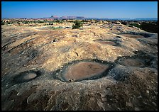 Empty pot holes on sandstone, Needles District. Canyonlands National Park, Utah, USA.