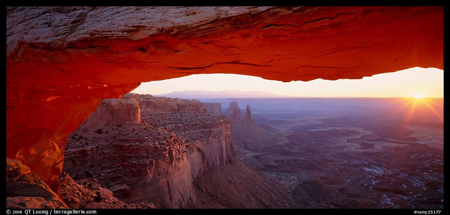 Sunrise and canyon landscape through Mesa Arch. Canyonlands National Park (color)
