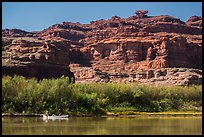 Canoeists and cliffs, Colorado River. Canyonlands National Park, Utah, USA. (color)