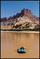 Woman paddling raft on Colorado River. Canyonlands National Park, Utah, USA. (color)