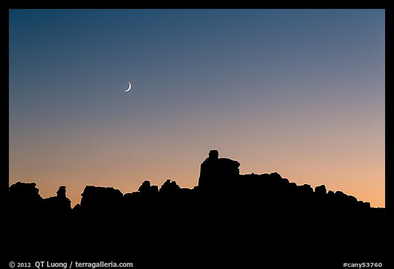 Crescent moon at sunset and Doll House spires. Canyonlands National Park (color)