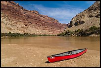 Red Canoe on beach near Confluence. Canyonlands National Park, Utah, USA. (color)