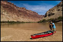 Canoeist and canoe near Confluence. Canyonlands National Park, Utah, USA. (color)