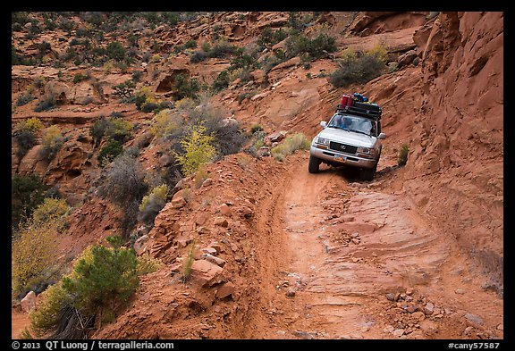 High clearance four-wheel-drive vehicle on the Flint Trail,  Orange Cliffs Unit,  Glen Canyon National Recreation Area, Utah. USA (color)