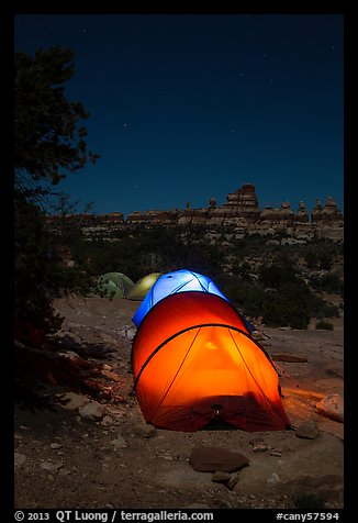 Lit tents at night in the Dollhouse. Canyonlands National Park (color)