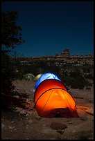 Lit tents at night in the Dollhouse. Canyonlands National Park, Utah, USA. (color)