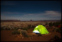 Tent overlooking the Maze at night. Canyonlands National Park, Utah, USA.