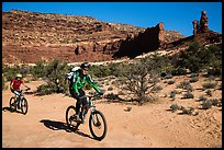Mountain bikers in Teapot Canyon, Maze District. Canyonlands National Park, Utah, USA. (color)