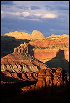 Cliffs and domes in the Waterpocket Fold, clearing storm, sunset. Capitol Reef National Park, Utah, USA.