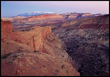 Waterpocket Fold and snowy mountains at dusk. Capitol Reef National Park ( color)