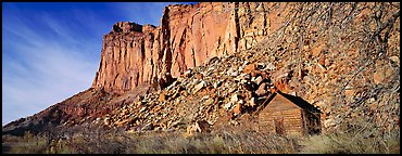 Fruita pioneer school house at the base of sandstone cliffs. Capitol Reef National Park (Panoramic color)