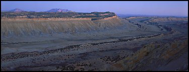 Long chain of cliffs of the Waterpocket Fold at dusk. Capitol Reef National Park, Utah, USA.