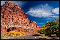 Rood, cliffs, and orchard in autumn. Capitol Reef National Park, Utah, USA. (color)