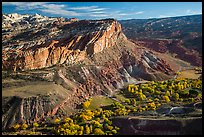 Waterpocket Fold cliffs and orchards from Rim Overlook in the fall. Capitol Reef National Park, Utah, USA. (color)