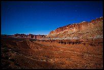 Fluted cliffs of Waterpocket Fold at night. Capitol Reef National Park, Utah, USA.