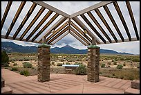 Courtyard, sign and mountains, Great Basin Visitor Center. Great Basin National Park ( color)