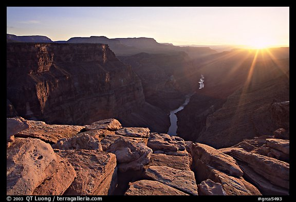 Cracked rocks and Colorado River at Toroweap, sunset. Grand Canyon National Park, Arizona, USA.