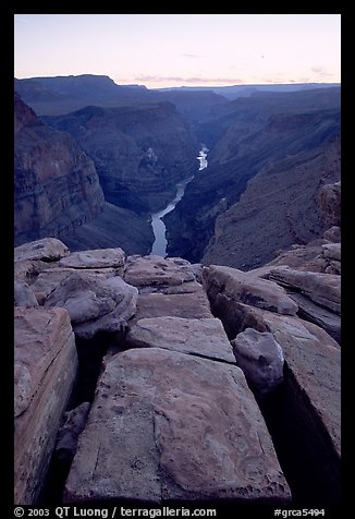 Cracks and Colorado River at Toroweap, dusk. Grand Canyon National Park, Arizona, USA.