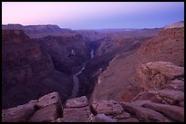 Cracked rocks and Colorado River at Toroweap, dawn. Grand Canyon National Park, Arizona, USA.